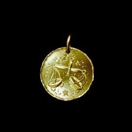 Libra in gold
